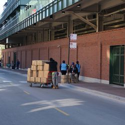 Employees waiting with supplies for access to the ballpark, on Waveland