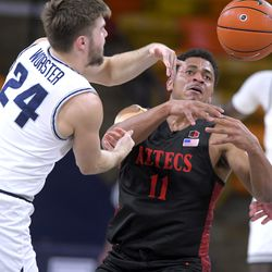 Utah State guard Rollie Worster (24) and San Diego State forward Matt Mitchell (11) go after a loose ball during the first half of an NCAA college basketball game Thursday, Jan. 14, 2021, in Logan, Utah.