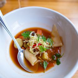 """Lamb neck lagman soup with tomato, fingerling potatoes, pickled red pepper, cabbage, egg noodles, and cilantro by Scott Garfinkel from the Momofuku Noodle Bar reunion at Brooklyn Star by <a href=""""http://www.flickr.com/photos/jmoranmoya/8624173048/in/pool-"""