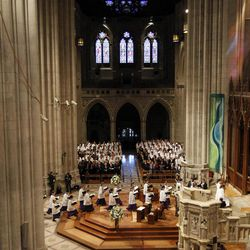 Members of the choir enter during the processional at the Washington National Cathedral in Washington, Thursday, Sept. 13, 2012, for  the national memorial service for the first man to walk on the moon, Neil Armstrong.