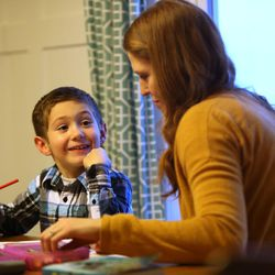 Oliver Widdison, 5, draws with his mother Emily Widdison at home in Saratoga Springs, Utah, Friday, Jan. 8, 2016.