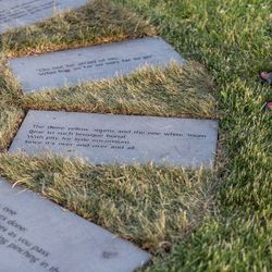 Stones circling the statue of Gwendolyn Brooks are inscribed with her poetry.   Erin Brown/For the Sun-Times