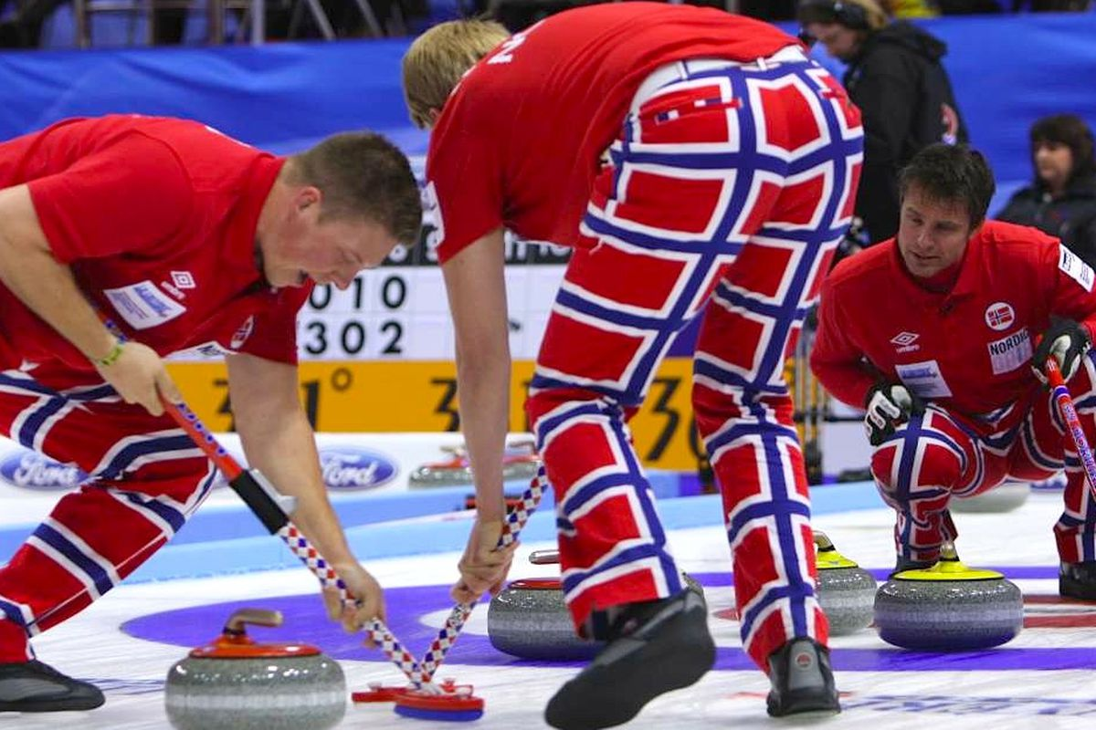 """The Norwegians, and their pants, in action. <a href=""""http://thecurlingnews.com"""">Image via The Curling News</a>."""