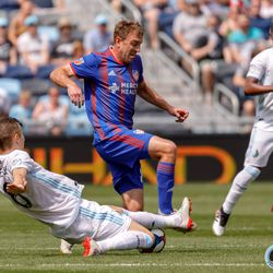 June 29, 2019 - Saint Paul, Minnesota, United States - Minnesota United midfielder Ján Greguš (8) goes in with a slide tackle to win the ball from FC Cincinnati midfielder Eric Alexander (16) during a match at Allianz Field.