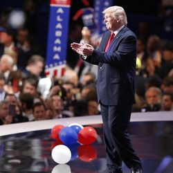 Donald Trump applauds the attendees  during the final night of the National Republican Convention in Cleveland on Thursday, July 21, 2016.