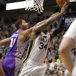Utah's CJ Miles drives past Sun's  Markieff Morris and is fouled  as the Utah Jazz are defeated by the Phoenix Suns 107-105 as they play NBA basketball Wednesday, April 4, 2012, in Salt Lake City, Utah.