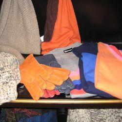 Raif Adelberg knit gloves, $390<br />Merola shearling gloves, $230<br />Bergdorf Goodman cashmere sweaters, $575-$750
