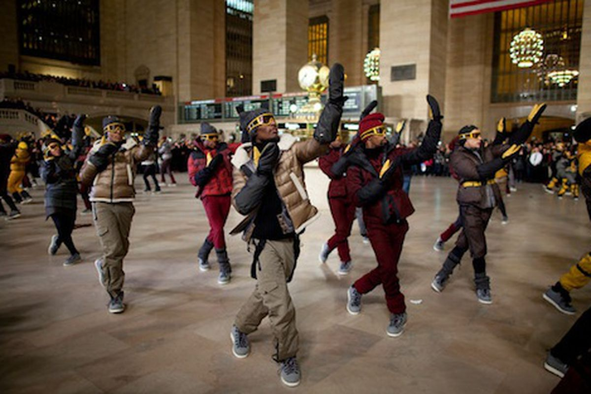 """<strong>Moncler</strong> encourages us to consider the ubiquitous puffy winter coat to be supremely dance-friendly. Image via <a href=""""http://ny.racked.com/archives/2011/02/14/full_video_and_photos_of_monclers_massive_grand_central_dancing_flashmob."""