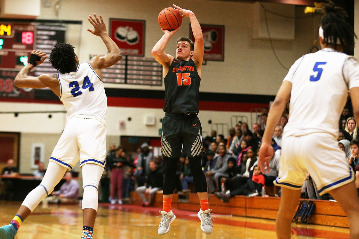 Evanston's Blake Peters (15) shoots from three as the Wildkits play Bloom.