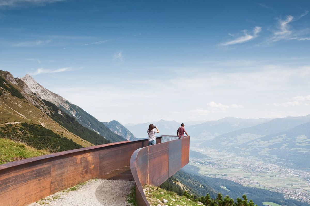 People standing on cantilevering path
