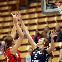 Utah's Emily Potter shoots over BYU's Jennifer Hamson during a women's basketball game at the Marriott Center in Provo on Saturday, Dec. 14, 2013. Utah won in double overtime 82-74.