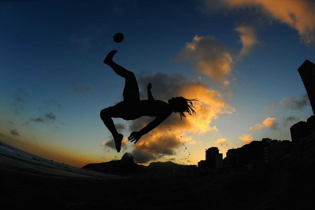 A man performs an overhead kick as he plays football on Ipanema beach ahead of the FIFA Confederations Cup Brazil 2013 on June 5, 2013 in Rio de Janeiro, Brazil.