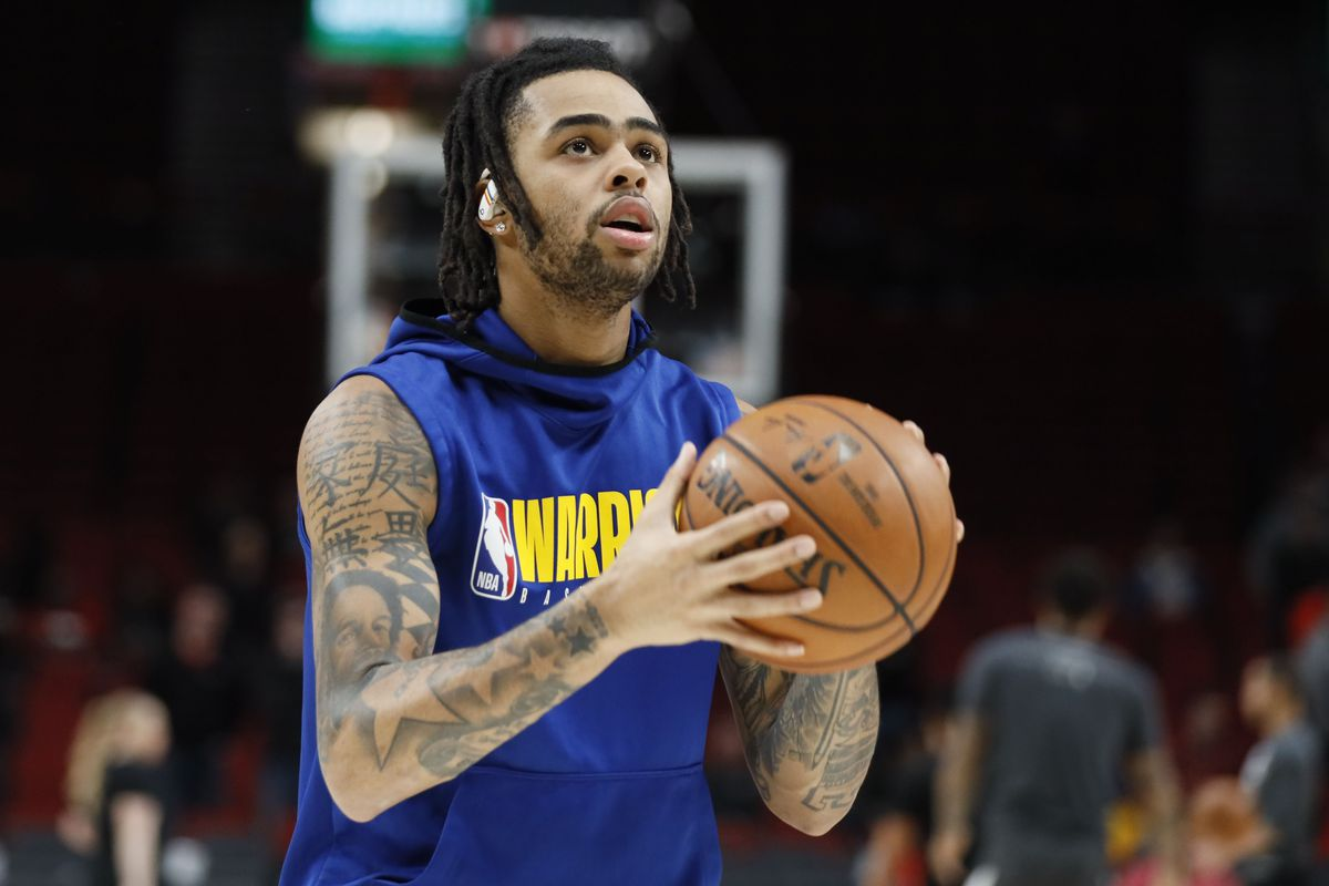 Golden State Warriors guard D'Angelo Russell warms up before a game against the Portland Trail Blazers at Moda Center.