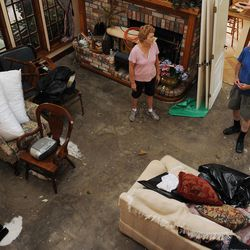 Pat Robichaux, left, and her husband Benny try to figure what the next step is, Friday, Aug. 31, 2012,  while cleaning up their River Forest subdivision home in LaPlace, La. Most home in the neighborhood took on water during flooding caused by Hurricane Isaac.