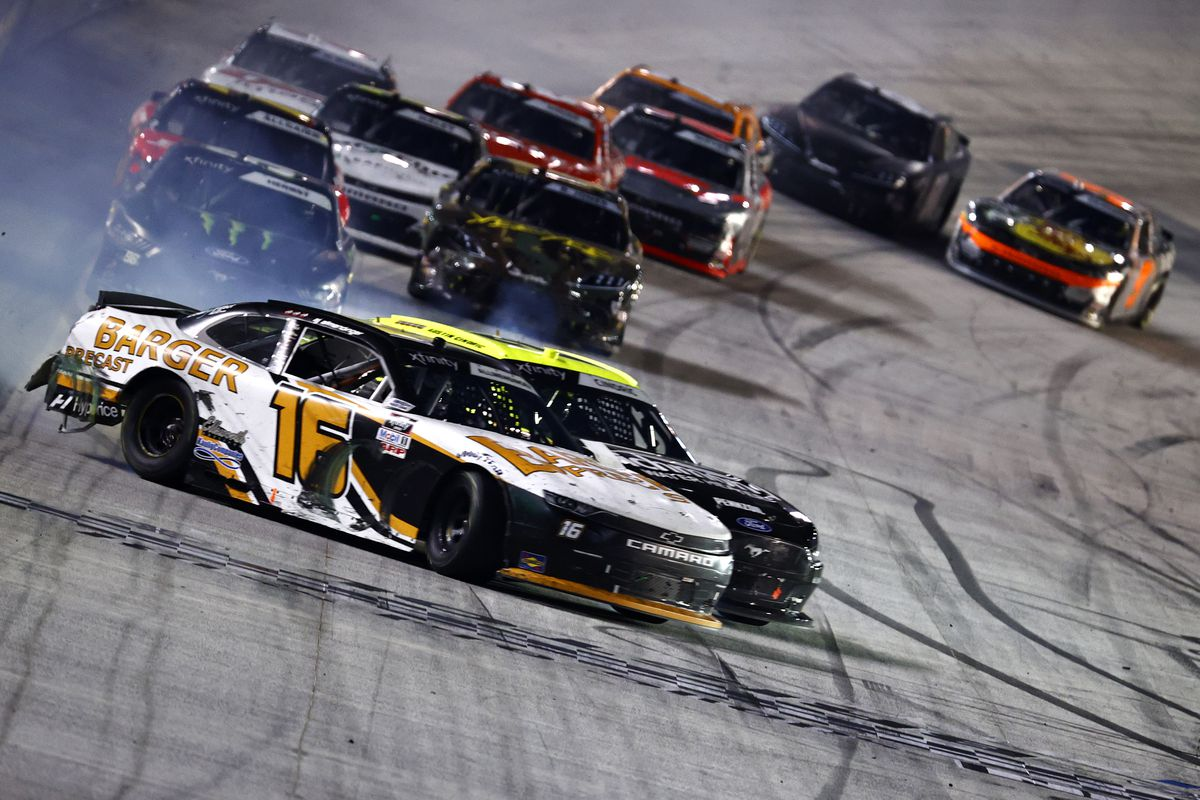 AJ Allmendinger, driver of the #16 Barger Precast Chevrolet, spins across the finish line after an incident with Austin Cindric, driver of the #22 Menards/Richmond Ford, to win the NASCAR Xfinity Series Food City 300 at Bristol Motor Speedway on September 17, 2021 in Bristol, Tennessee.