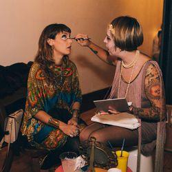 Beauty guru Corrine Kaz giving jewelry designer Jesse Southern a feline face.