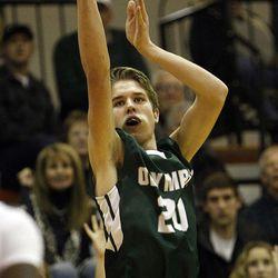 Olympus forward Isaac Monson (20) shoots a basket in a 4A regional boys basketball game against Murray at Murray High School, Tuesday, Jan. 12, 2016.