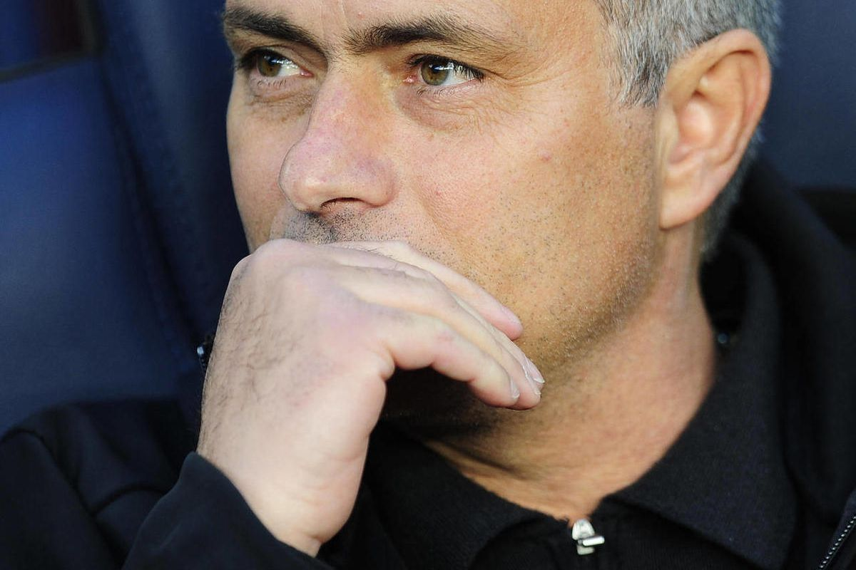 Real Madrid's coach Jose Mourinho, from Portugal, gestures prior to the match against FC Barcelona during a Spanish La Liga soccer match a at the Camp Nou stadium in Barcelona, Spain, Saturday, April 21, 2012.