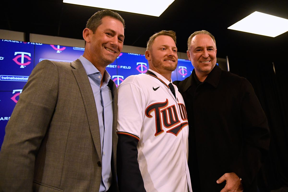 Josh Donaldson of the Minnesota Twins poses for a photo with his agents Josh Goldberg and Dan Lozano as the Twins introduce Donaldson at Target Field on January 22, 2020 in Minneapolis, Minnesota.