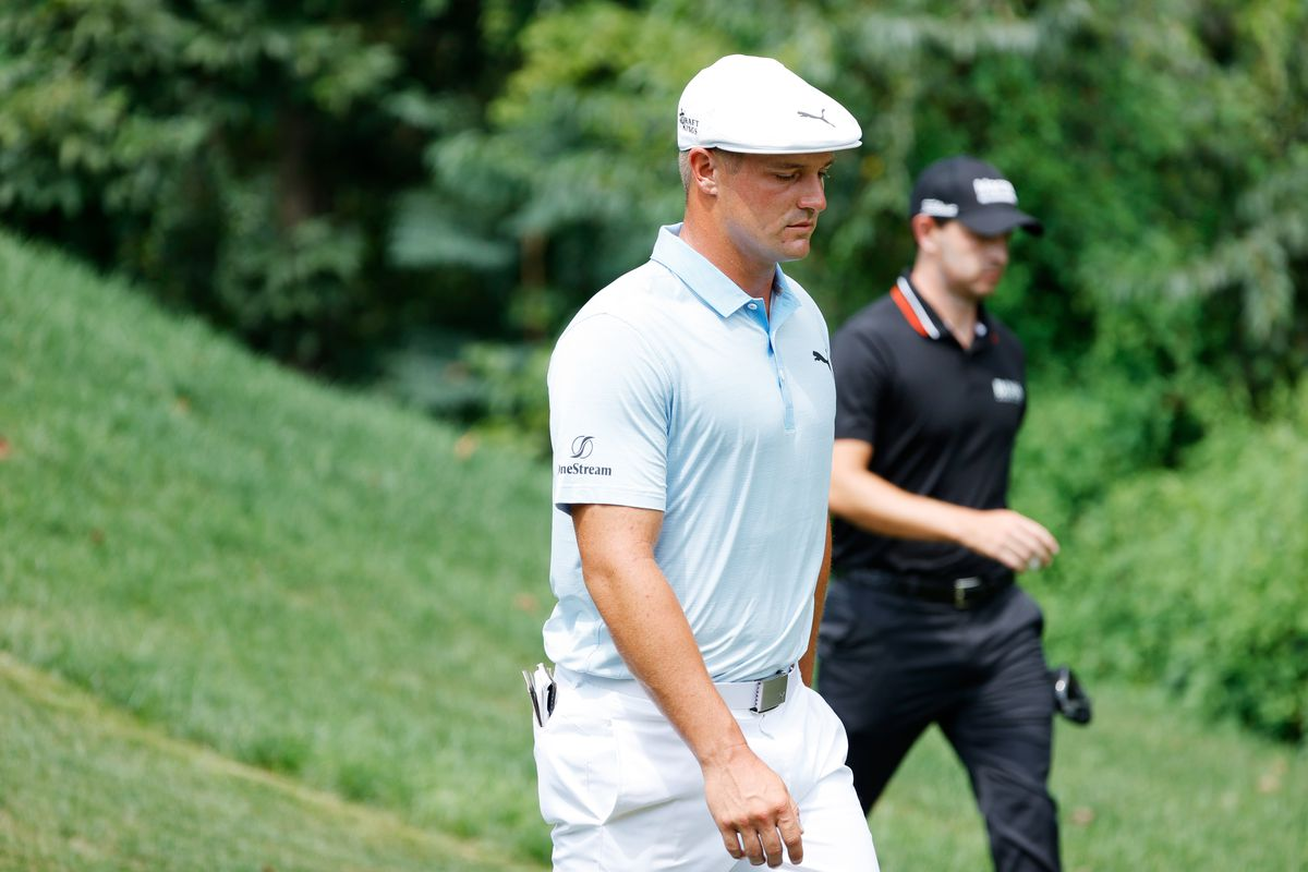 Bryson DeChambeau of the United States and Patrick Cantlay of the United States walks from the second tee during the third round of the BMW Championship at Caves Valley Golf Club on August 28, 2021 in Owings Mills, Maryland.