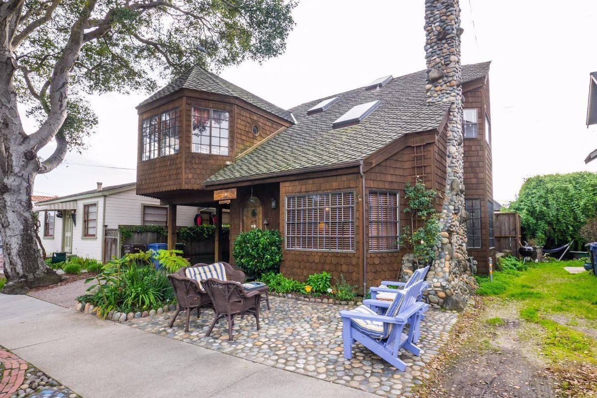 Exterior of Santa Cruz home, brown shingled, stone chimney.
