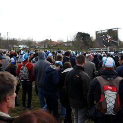 Fans watch the final sprint