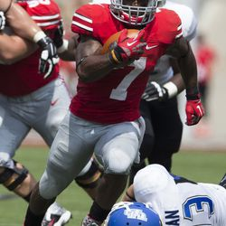 Ohio State Buckeyes running back Jordan Hall (7) breaks a tackle attempted by Buffalo Bulls linebacker Blake Bean (33) on his way to his second touchdown of the game at Ohio Stadium.