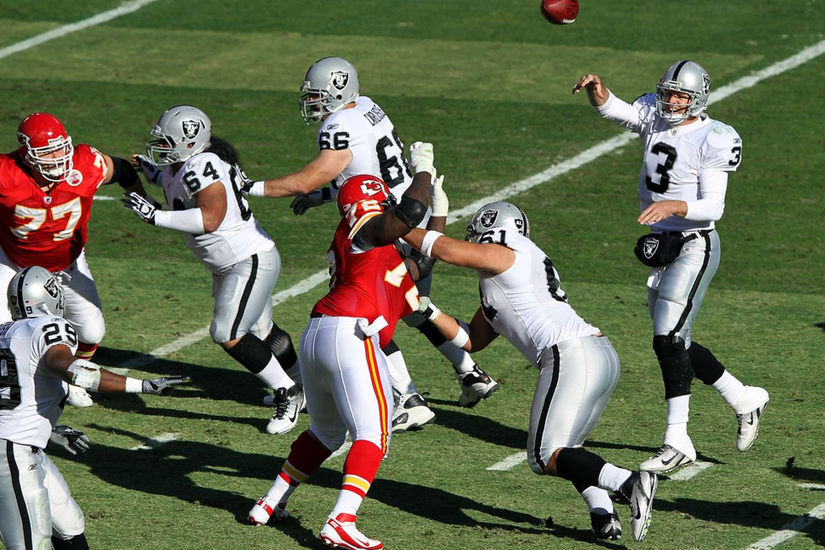 KANSAS CITY, MO - DECEMBER 24:  Quarterback Carson Palmer #3 of the Oakland Raiders passes during the game against the Kansas City Chiefs on December 24, 2011 at Arrowhead Stadium in Kansas City, Missouri.  (Photo by Jamie Squire/Getty Images)