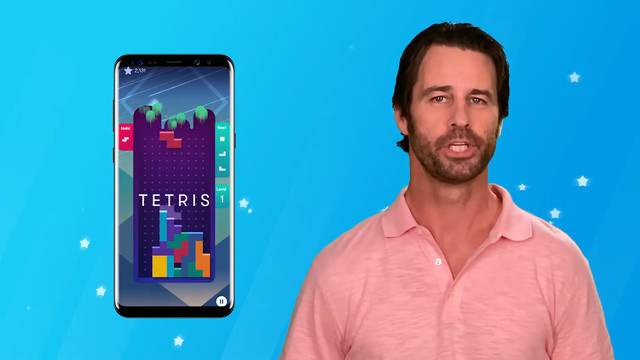 Millen Baird on a blue screen with a smartphone floating next to him showing Tetris on it