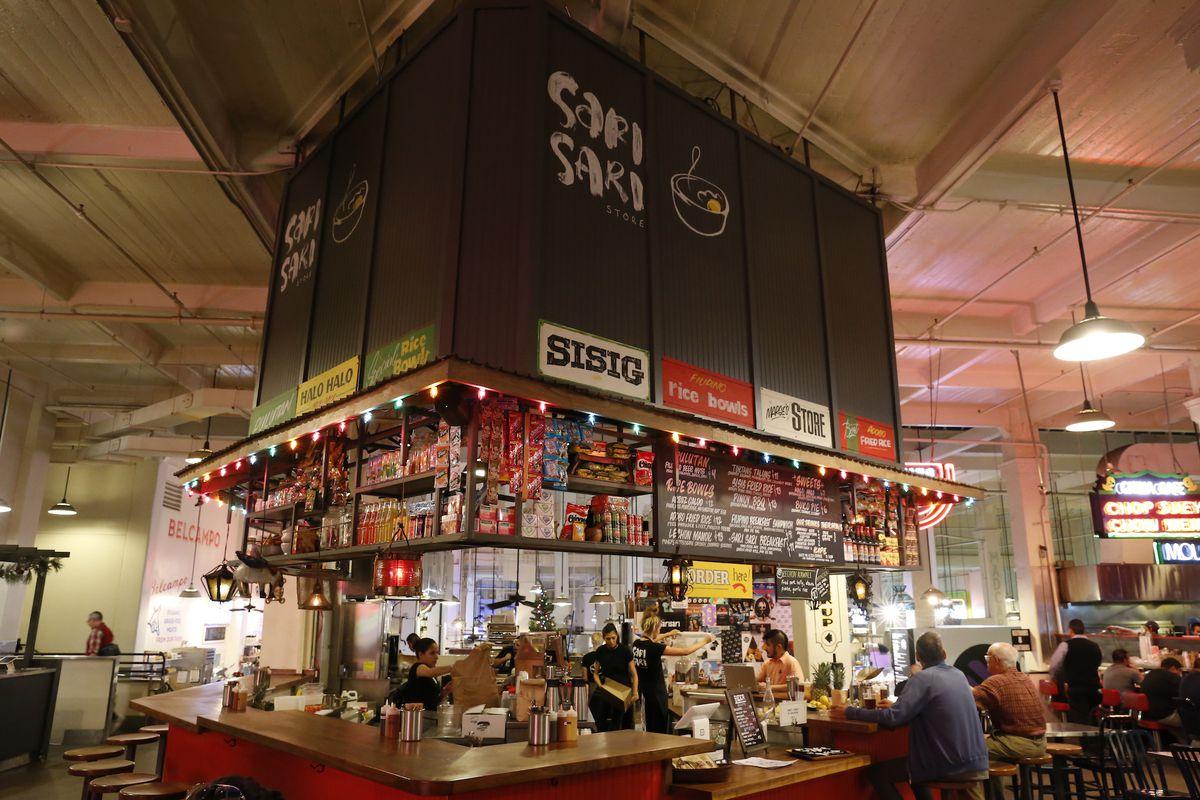 Night lights and customers eating at Sari Sari Store inside Grand Central Market.