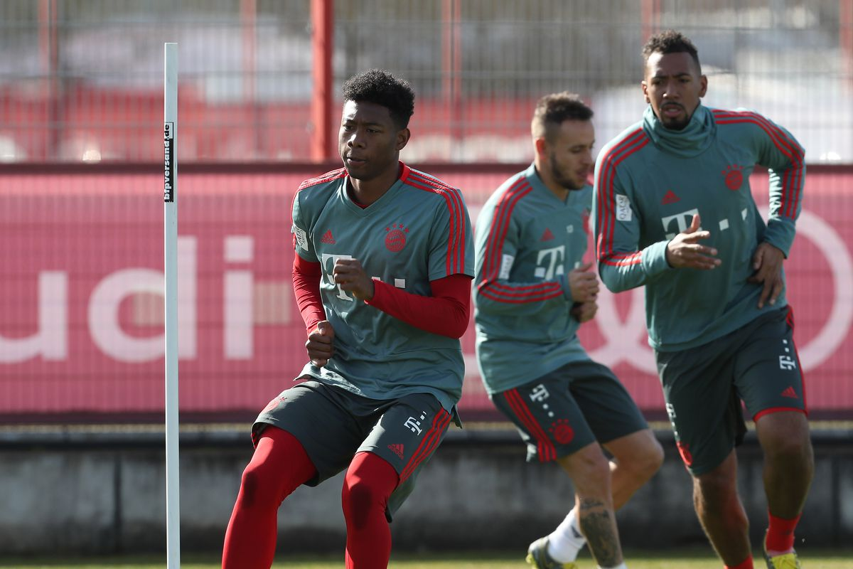FC Bayern Muenchen - Training Session MUNICH, GERMANY - FEBRUARY 26: David Alaba (L), Jerome Boateng (R) and Rafinha of FC Bayern Muenchen practice during a training session at the club's Saebener Strasse training ground on February 26, 2019 in Munich, Germany.