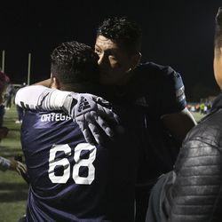 Corner Canyon's Hugo Ortega-Sanchez is consoled by family after a loss to Lone Peak at Corner Canyon High School in Draper on Thursday, Oct. 7, 2021.