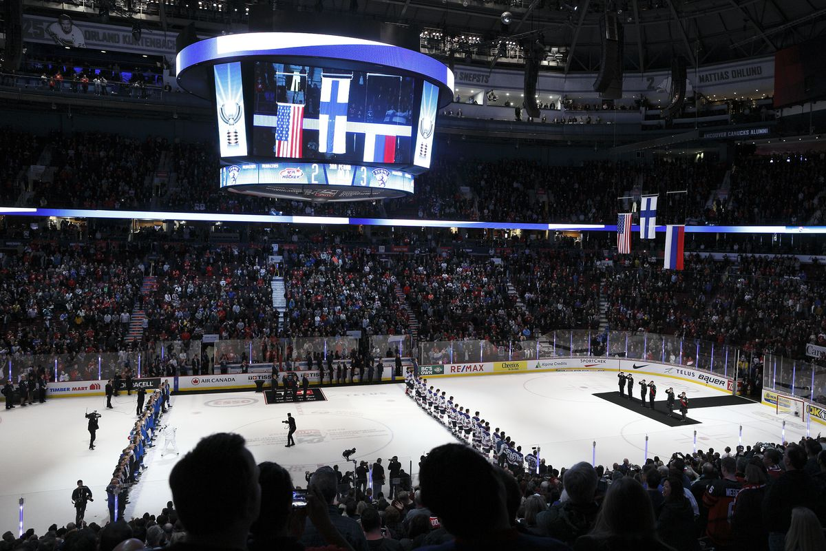 A general view of the Finnish, American and Russian flags being raised following the gold medal match between Finland and the United States at the IIHF World Junior Championships at Rogers Arena on January 5, 2019 in Vancouver, British Columbia, Canada.