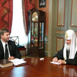 In this July 3, 2009 photo taken from the website of the Russian Orthodox Church, Russian Orthodox Patriarch Kirill, right, meets with Justice Minister Alexander Konovalov in Moscow. This photo, posted on the church's web-site caused a scandal when the site's editors first erased the patriarch's wristwatch, but later apologized for doctoring the photo.