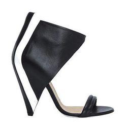 "<b>Iro</b> Ankle Cuff Cone Heel Sandal, <a href=""http://www.intermixonline.com/product/iro+ankle+cuff+cone+heel+sandal-+black-white.do?sortby=ourPicks&CurrentCat=106368"">$795</a> at Intermix"