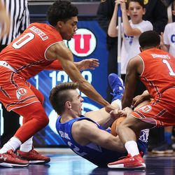 Brigham Young Cougars guard Zac Seljaas (2) is surrounded by Utah Utes in Provo on Saturday, Dec. 16, 2017. BYU won 77-65.