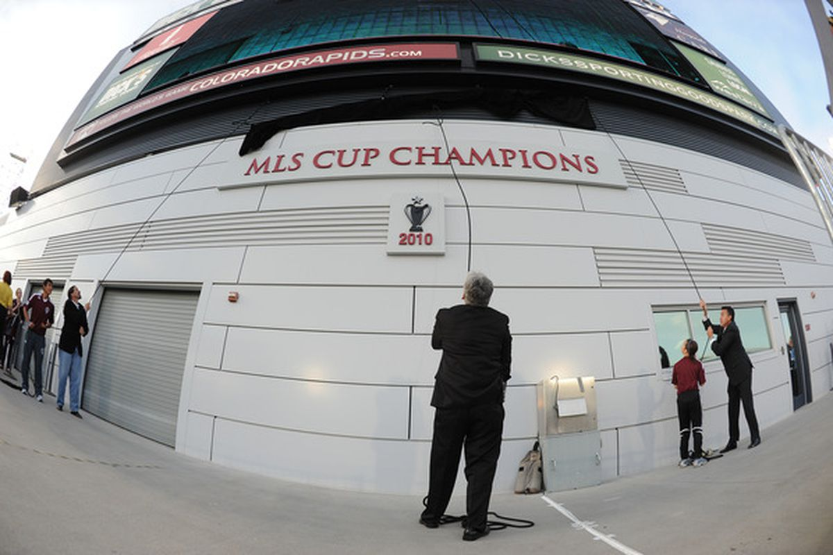 Paul Bravo and Marcello Balboa unveil the MLS Cup Champions plaque in 2011.
