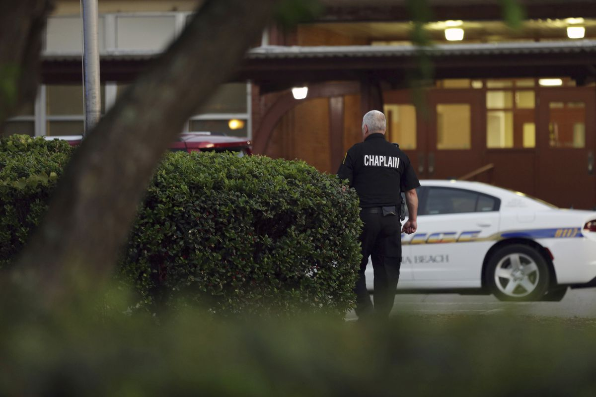 A police chaplain heads toward Princess Anne Middle School in Virginia Beach, on Friday, May 31, 2019.