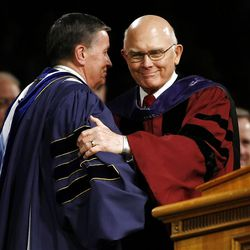 BYU President Cecil O. Samuelson, left, shakes hands with Elder Dallin H. Oaks as Elder Oaks steps to the podium to deliver the commencement address at Spring Commencement Exercises at BYU Thursday, April 19, 2012 in the Marriott Center.
