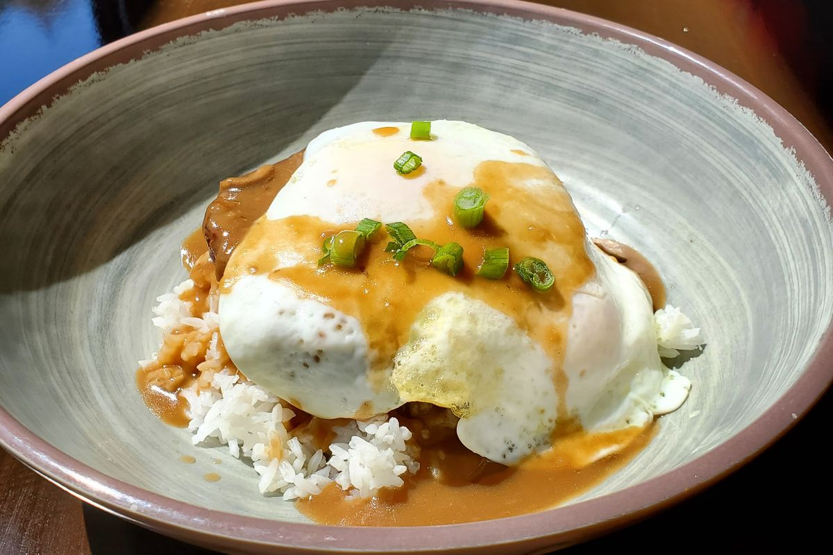 Loco moco with a hamburger patty, steamed rice, and an egg any style, served with mushroom gravy
