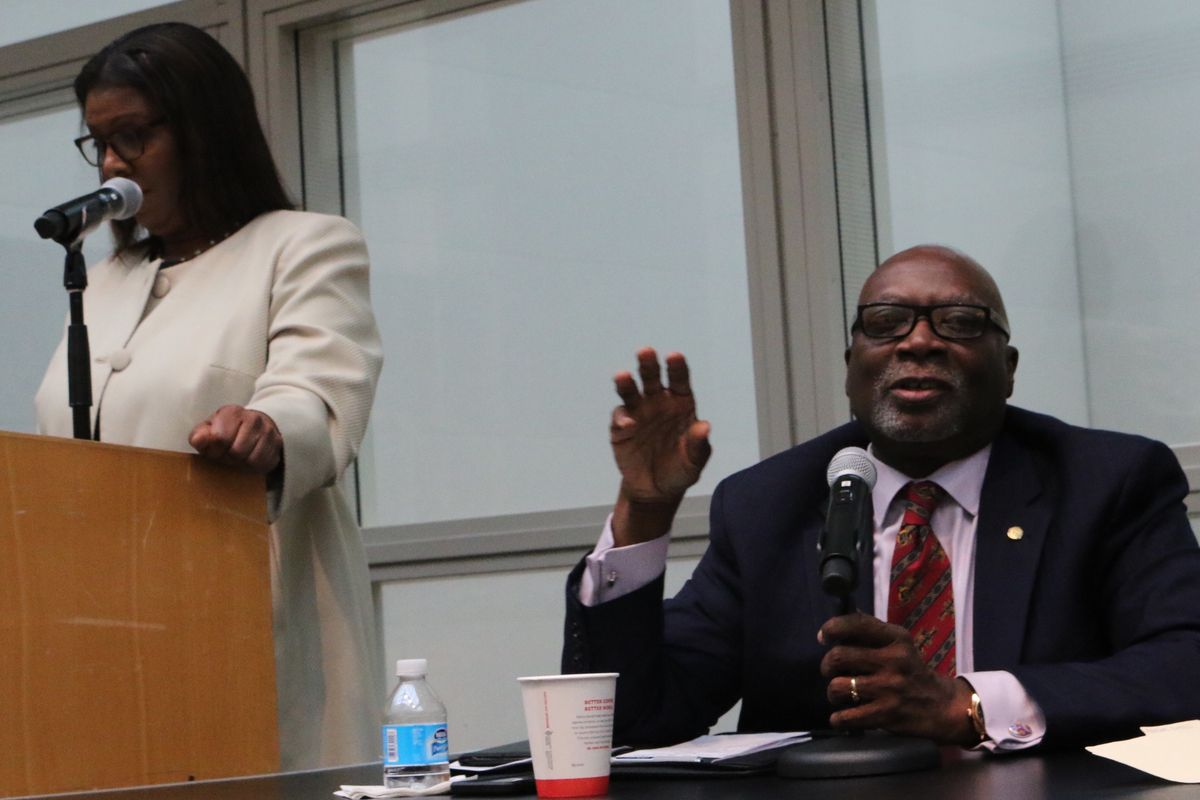 Principal union president Ernest Logan (right) criticized the city's Renewal program at a panel moderated by Public Advocate Letitia James (left).