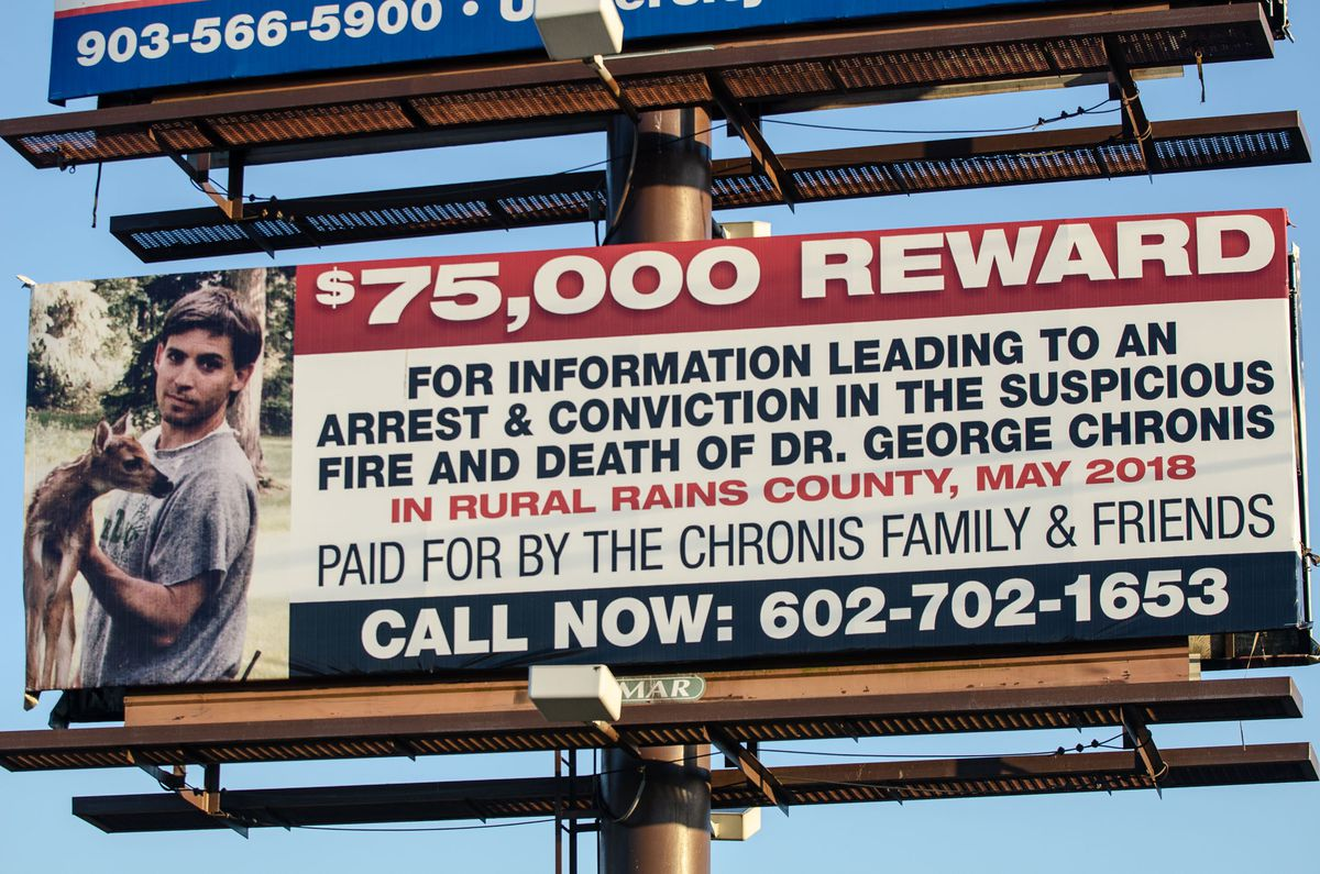 A billboard on U.S. 69 in Alba, Texas, offers a $75,000 reward for information leading to an arrest and conviction in the death of Dr. George Chronis, a 57-year-old obstetrician and gynecologist from Palos Park, found dead on his remote property in Rains County, Texas, on May 4, 2018.