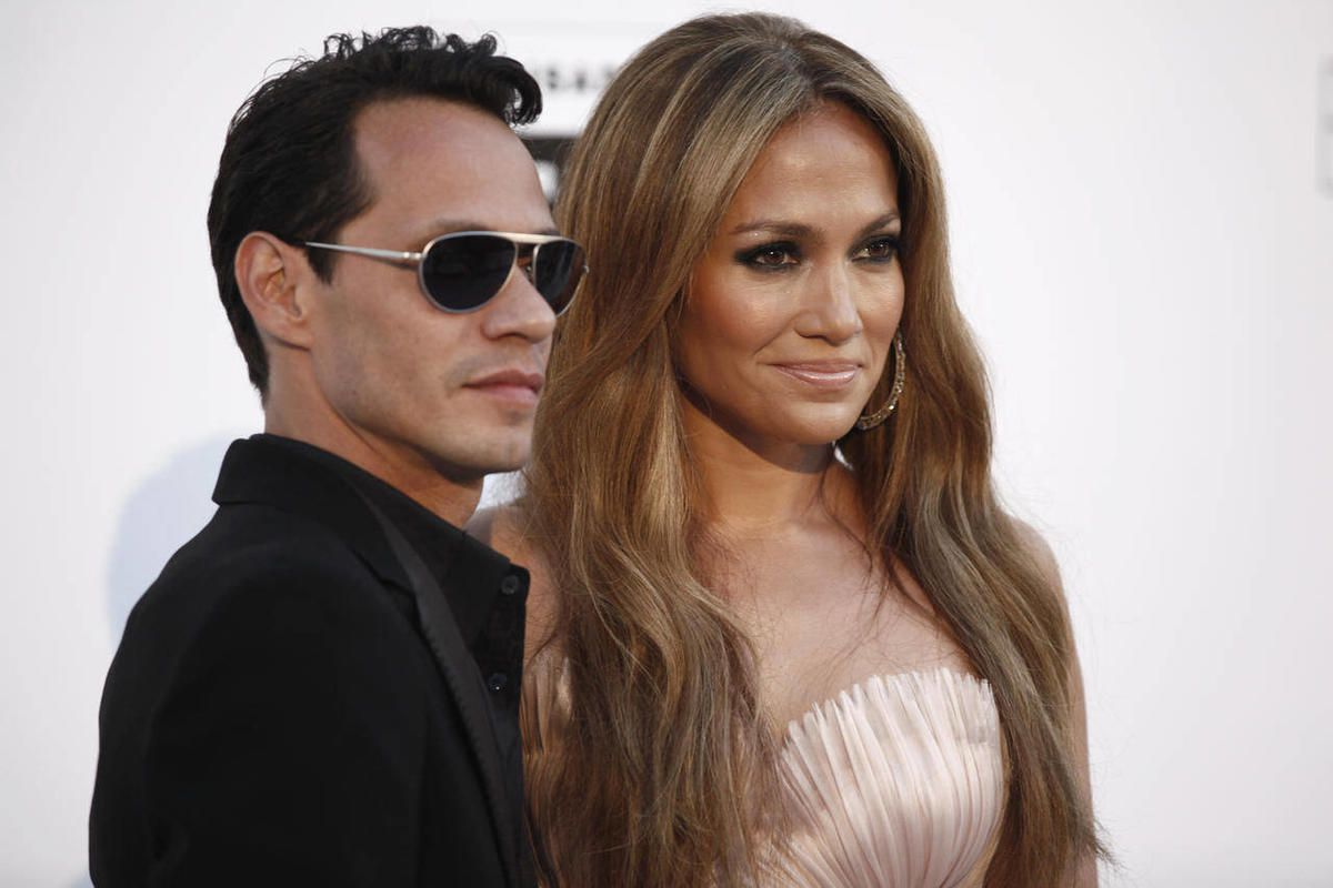 FILE  - In a May 20, 2010 file photo, singers Mark Anthony and Jennifer Lopez arrive for the amfAR Cinema Against AIDS benefit during the 63rd Cannes international film festival, in Cap d'Antibes, southern France. The exes have announced that they'll perf