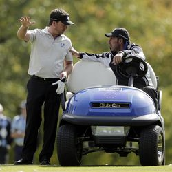 European team captain Jose Maria Olazabal, left, talks to Graeme McDowell during a practice round at the Ryder Cup PGA golf tournament Wednesday, Sept. 26, 2012, at the Medinah Country Club in Medinah, Ill.