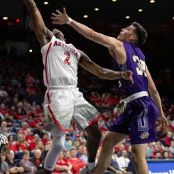Arizona's Brandon Williams (2) tosses the ball up past Western New Mexico's Eddie Giron during the Arizona-Western New Mexico University game in McKale Center on October 30 2018 in Tucson, Ariz.