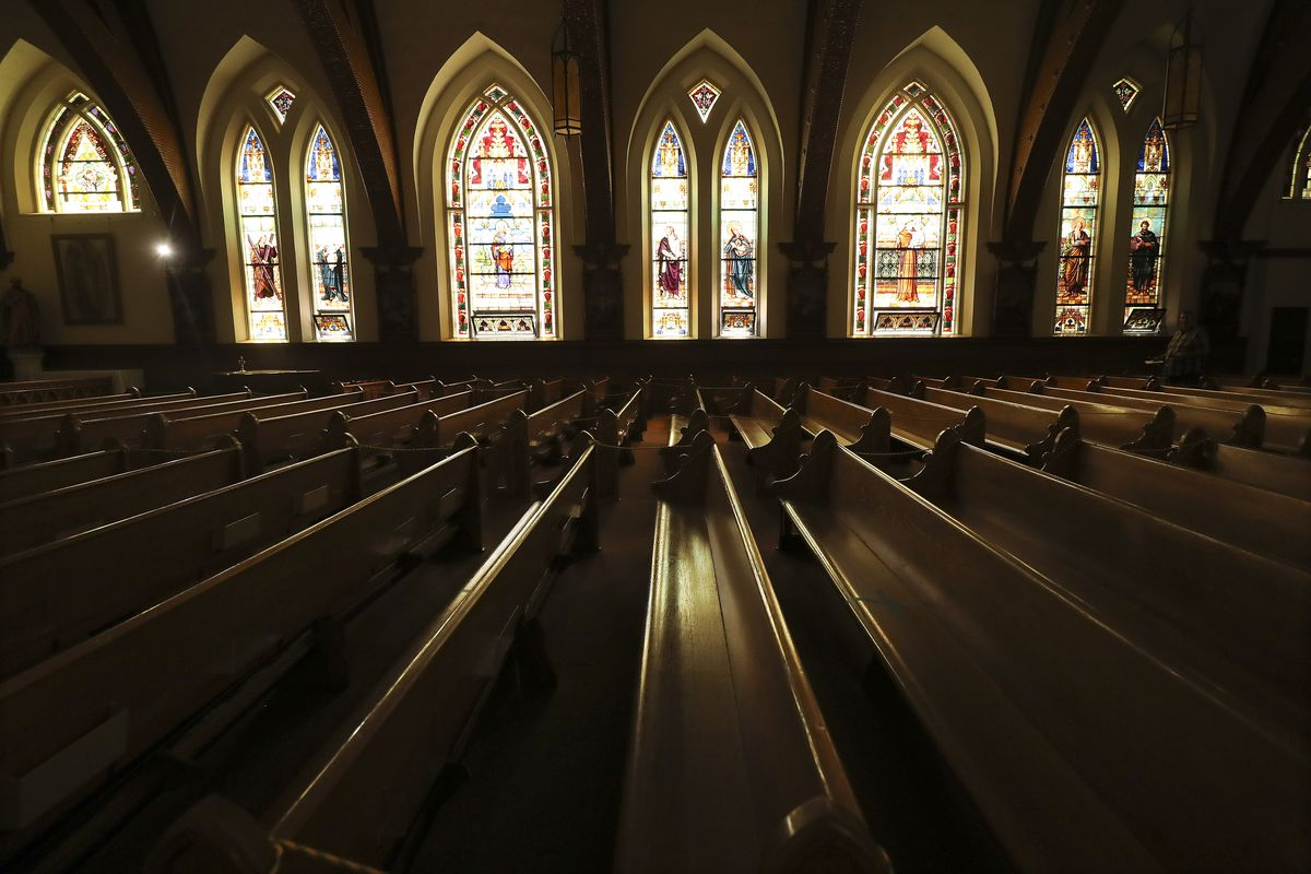 Light shines through the stained glass windows in St. Joseph Catholic Church in Ogden on Tuesday, June 2, 2020. The church is getting a new roof thanks to a donation from the estate of a deceased parishioner.