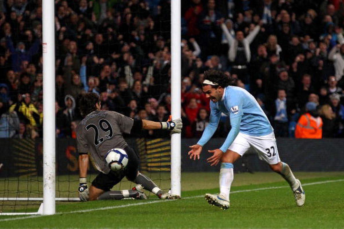 Carlos Tevez celebrates a goal against Wigan in 2009-10.