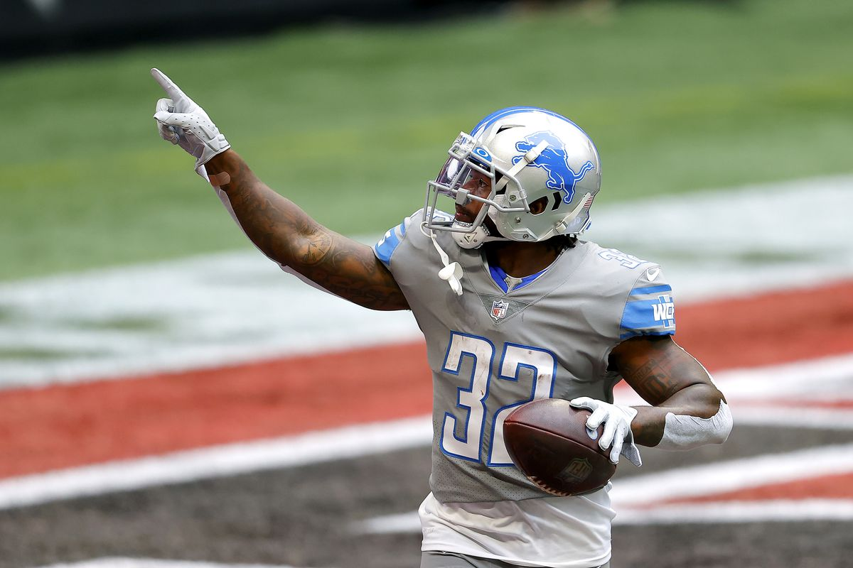 D'Andre Swift #32 of the Detroit Lions celebrates his rushing touchdown against the Atlanta Falcons during the first half at Mercedes-Benz Stadium on October 25, 2020 in Atlanta, Georgia.