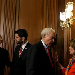 Sen. Orrin Hatch, R-Utah, president pro tem of the U.S. Senate and member and former chairman of the Senate Judiciary Committee, confers with House Democratic Leader Nancy Pelosi, D-Calif., as Sen. Lamar Alexander,  R-Tenn., chairman of the Senate Health, Education, Labor and Pensions Committee, left, speaks with House Speaker Paul Ryan, R-Wis., after a bipartisan, bicameral enrollment ceremony for the Every Student Succeeds Act (S. 1177) at the Capitol in Washington, D.C., on Wednesday, Dec. 9, 2015.