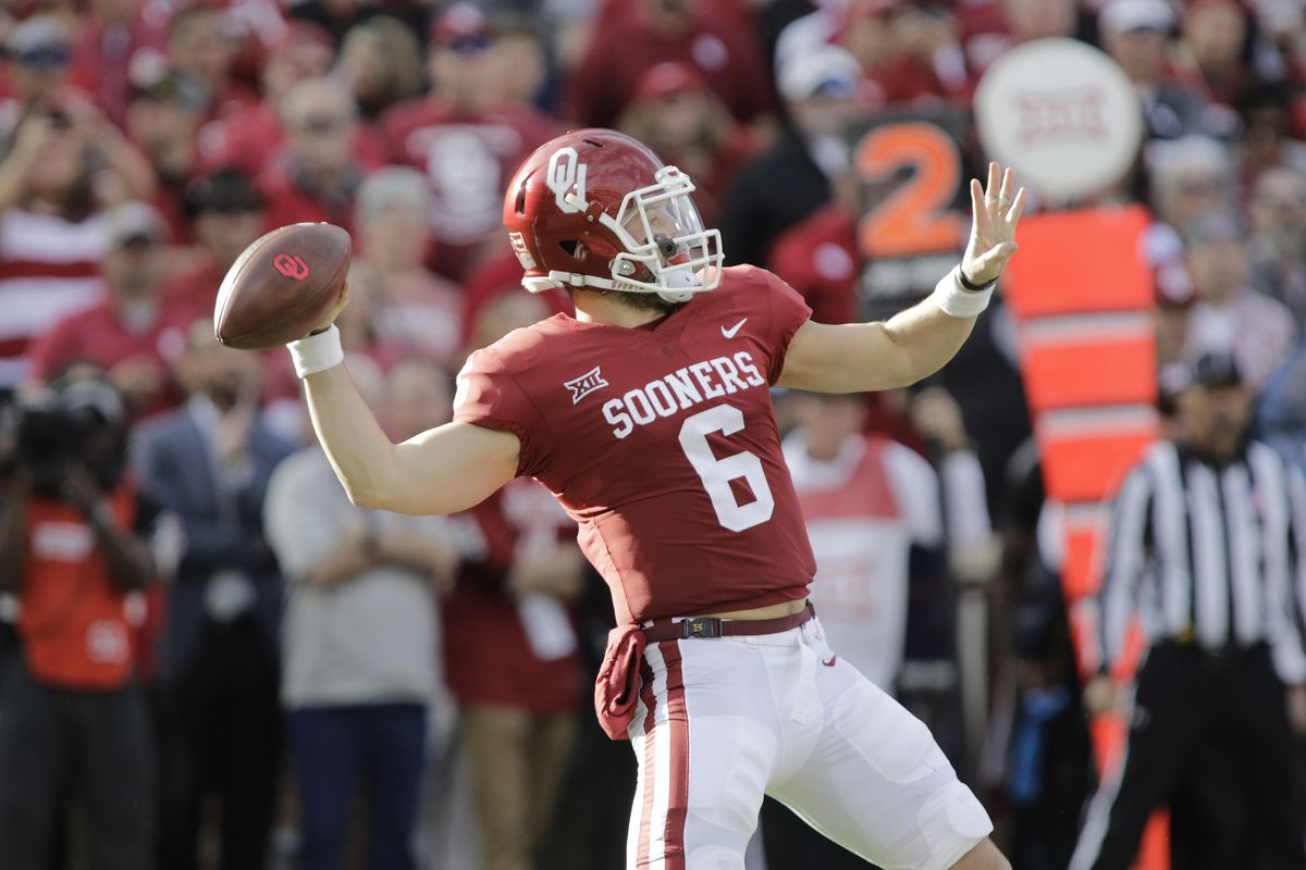 NORMAN, OK:  Oklahoma Sooners quarterback Baker Mayfield (6) looks to throw against the West Virginia Mountaineers defense at Gaylord Family Oklahoma Memorial Stadium.